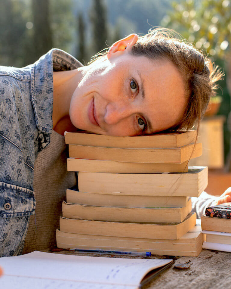 woman with her head on books